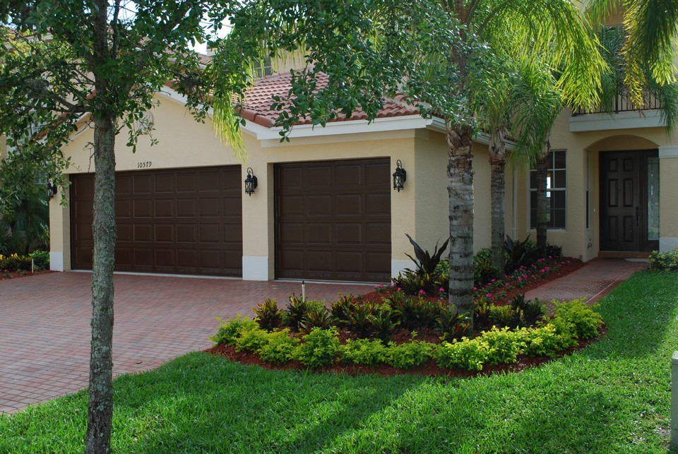 welcome home! beautiful landscaping and freshly painted garage doors and front door greet you at your new home.