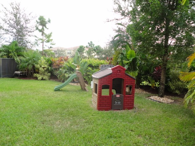 backyard the private &  lushly landscaped backyard has room for a pool,
